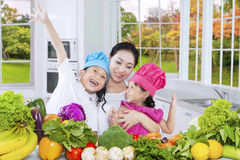 Happy family cooking vegetables in kitchen Royalty Free Stock Image
