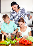 Happy family cooking vegetarian lunch Stock Photos