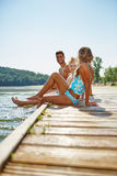Happy family cooling their feet at a lake Stock Photography