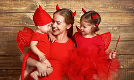 Happy family with costumes devil prepares for Halloween Royalty Free Stock Photography