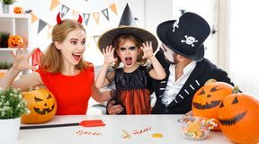 Happy family in costumes   for halloween at home Royalty Free Stock Images