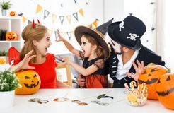 Happy family in costumes   for halloween at home Stock Images
