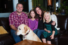 Happy family. Family on the couch with dog at home Royalty Free Stock Photography