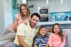 Happy family on the couch Royalty Free Stock Photos
