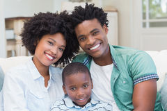 Happy family on the couch Royalty Free Stock Image