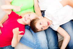 Happy family on the couch Stock Photos