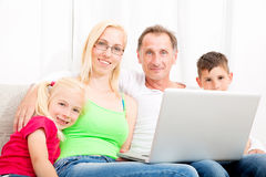 Happy family on the couch Royalty Free Stock Photography