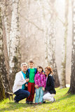 Happy family in countryside stock photos