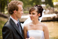 Happy family couple. Bride and groom, looking at each other straight in the eye stock photos
