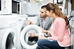 Free Happy Family Couple Buying New Clothes Washer Royalty Free Stock Photography - 70796047