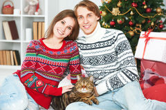 Happy family couple and cat in Christmas at home Stock Image