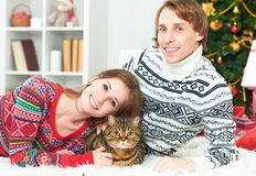 Happy family couple and cat in Christmas at home Stock Images