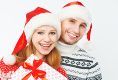 Happy family couple with Christmas presents on white Royalty Free Stock Image