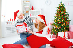 Happy  family couple with a gift on Christmas at home Stock Photography