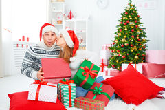 Happy  family couple with a gift on Christmas at home Royalty Free Stock Image