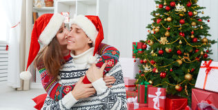 Happy family couple kissing Christmas at home Royalty Free Stock Photography
