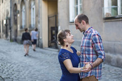 Happy  family. Couple in love dancing on the pavement of the old town. Stock Images