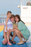 Happy family on cruise liner deck Stock Image