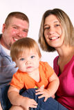 Happy Family, Curious Baby. A mother and father watch their inquisitive baby girl Stock Photography