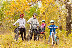 Happy family cycling outdoors, on bikes Stock Photography
