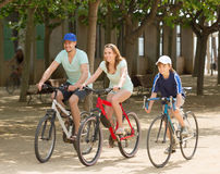 Happy family cycling in park togetherness Royalty Free Stock Images