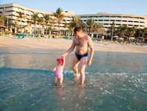 Happy family: dad and child on beach in Persian Gulf ,Dubai  Tanning near ocean, tropical resort Stock Image