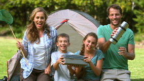 Happy family dancing in front of the tent stock video footage