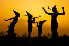 Happy  family dancing on the  road at the  sunset time. Evening Stock Image