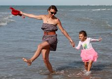 Happy family dancing at sea. Happy family mom and child dancing at sea stock images