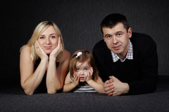 Happy family on dark background Royalty Free Stock Images