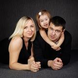 Happy family on dark background Stock Image