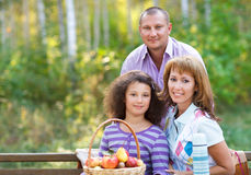 Happy family with daughter on autumn picnic Royalty Free Stock Photos