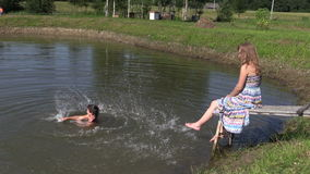 Happy family daughter girl splash pond water and pregnant mother stock video footage