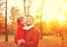 Happy family. daughter kissing and hugging her dad on a walk in Stock Image