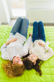 Happy family. daughter and mother lying next to each other on a bed Stock Photo