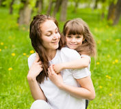 Happy family - daughter, and mother in park Royalty Free Stock Photos