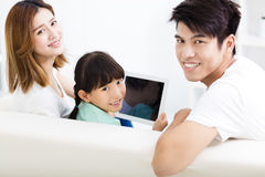 Happy family and daughter  watching tablet on sofa Royalty Free Stock Photos