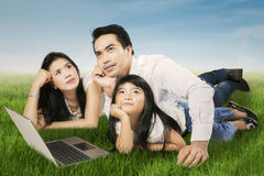 Happy family daydreaming outdoors Royalty Free Stock Photo