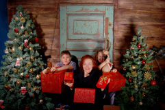 Happy family  decorate Christmas tree . Stock Photo