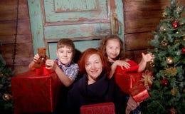 Happy family  decorate Christmas tree . Stock Photography