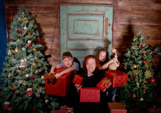 Happy family  decorate Christmas tree . Royalty Free Stock Images