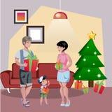 Happy family decorates the Christmas tree. Stock Photos