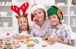 Happy family decorating christmas cookies Stock Image