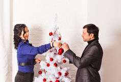 Happy family decorating a Christmas tree Stock Image