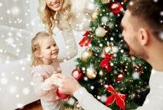 Happy family decorating christmas tree at home Royalty Free Stock Photo