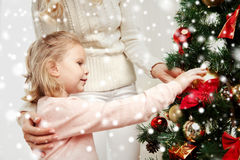 Happy family decorating christmas tree at home Royalty Free Stock Photo