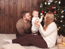 Happy family decorating christmas tree Royalty Free Stock Photos