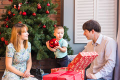 Happy Family Decorating Christmas Tree together. Father, Mother And Son. Cute Child. Kid.  Stock Image
