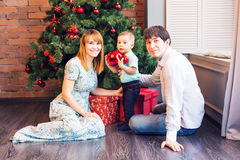 Happy Family Decorating Christmas Tree together. Father, Mother And Son. Cute Child. Kid.  Stock Photography