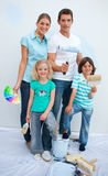 Happy family decorating their new house Royalty Free Stock Photos